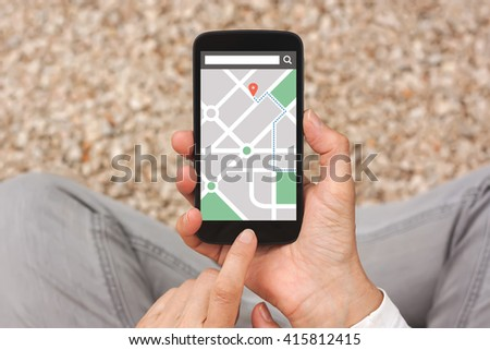 Hands holding smart phone with map gps navigation application on screen. All screen content is designed by me - stock photo