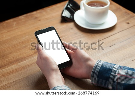 hands holding smartphone - stock photo
