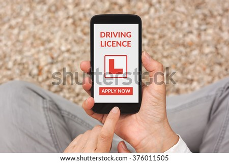 Hands holding smartphone with driving licence app mock up on screen. All screen content is designed by me - stock photo