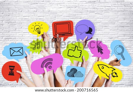 Hands holding social media icons. - stock photo