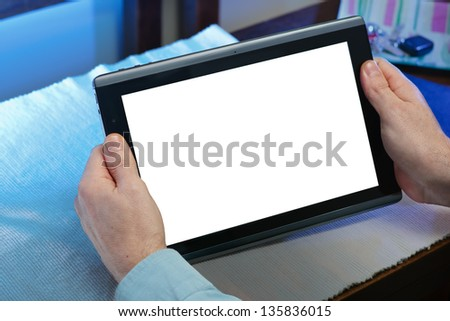 hands holding tablet-pc with the white screen and a background of blue lights - stock photo