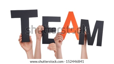Hands Holding the Black and Orange Letters Team, Isolated - stock photo