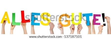 hands holding the german word ALLES GUTE! which means congratulations/best wishes, isolated - stock photo