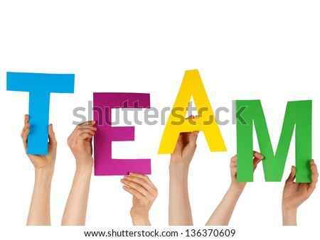 hands holding the letters building TEAM, isolated - stock photo