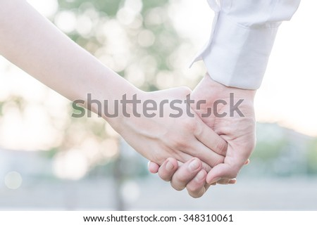 hands holding together for cheerful healing love