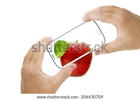 Hands holding touch screen smart phone and taking red apple picture. Isolated on white background - stock photo
