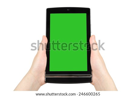 Hands holding touch screen tablet pc with green screen  - stock photo