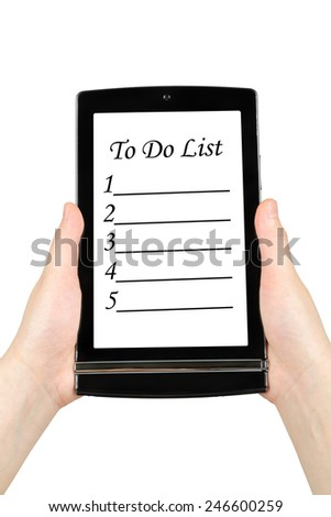 Hands holding touch screen tablet with to do list on screen - stock photo