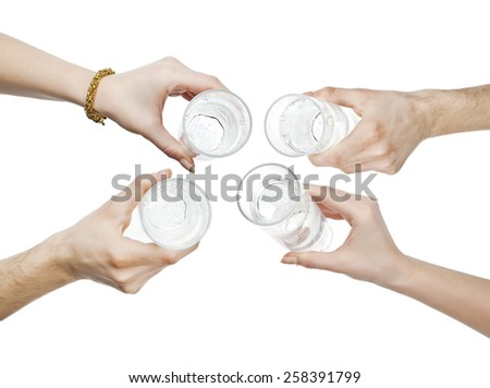 hands holding water glass cheering - stock photo