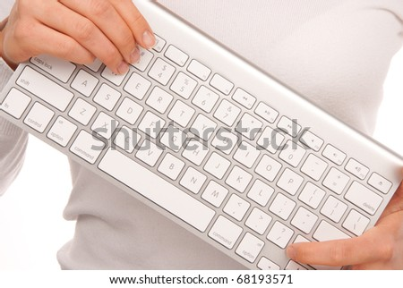 Hands holding white remote laptop keyboard modern and stylish that can be connected to PC computer wirelessly isolated on white background - stock photo