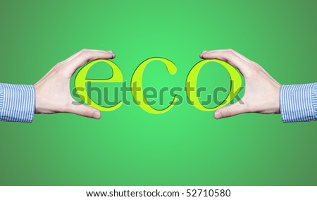 """Hands holding word """"eco"""" - stock photo"""