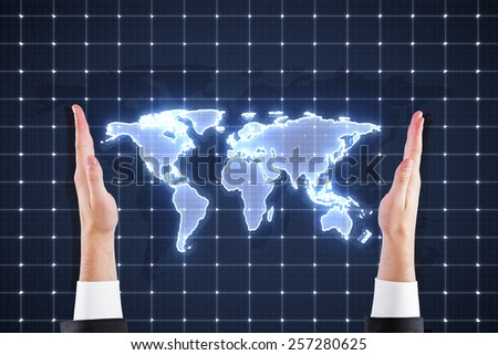 hands  holding world map interface on blue background - stock photo