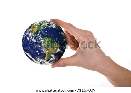 Hands holding world over white background. Close-up photo.
