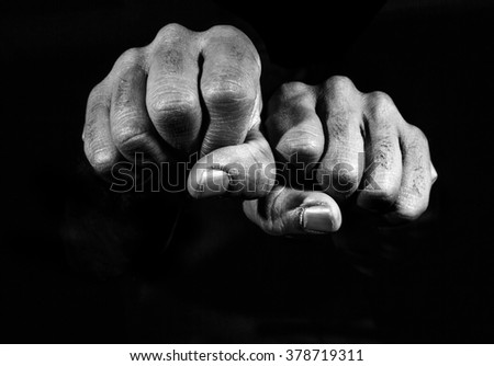Hands in black and white. - stock photo
