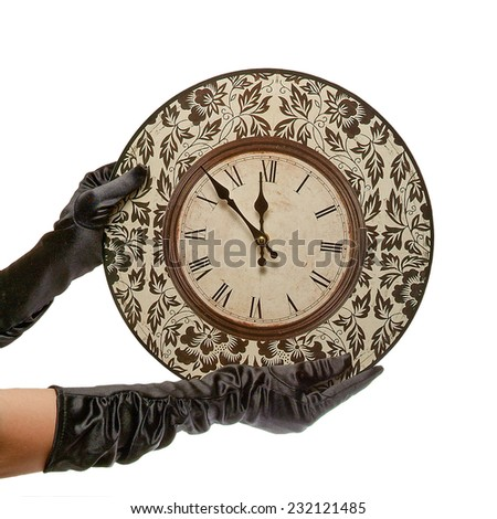 hands in black gloves hold retro clock. isolated on white background with path - stock photo