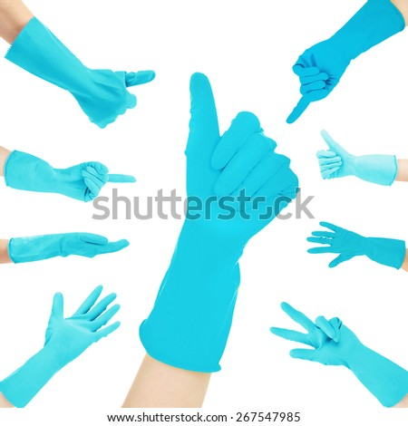 Hands in blue gloves gesturing numbers isolated on white - stock photo