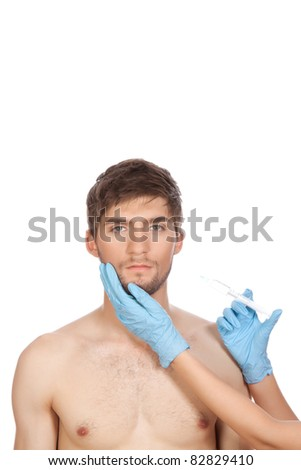 hands in blue gloves with syringe hold attractive young handsome male face, head with injection isolated over white background concept of plastic surgery, skincare, man beauty, spa center - stock photo
