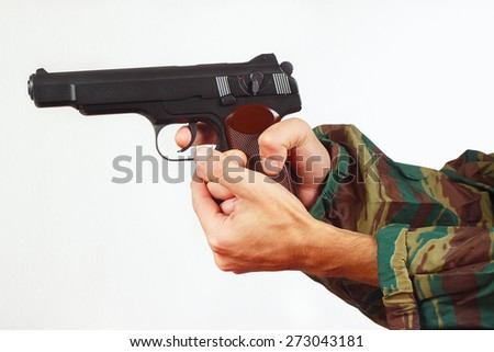 Hands in camouflage uniform with automatic army gun on a white background - stock photo