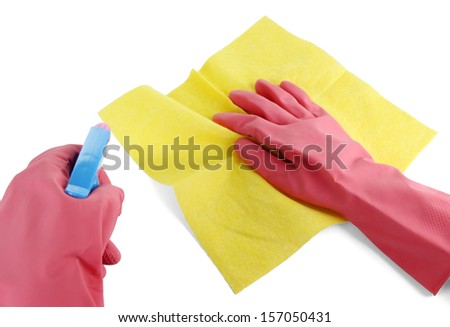 Hands in gloves wiping surface with yellow rag and spray isolated on white