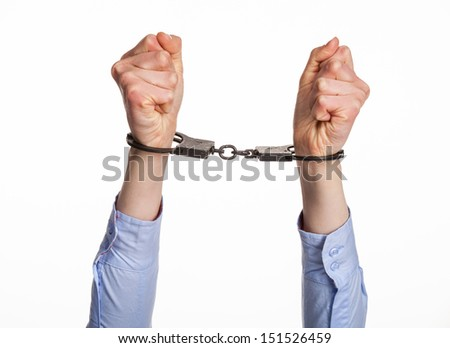 Hands in handcuffs; isolated on white - stock photo