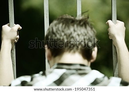 Hands in jail - stock photo
