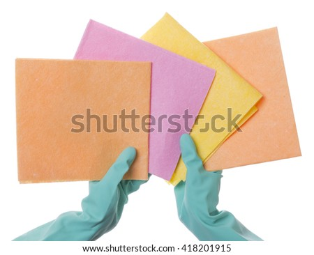 hands in rubber gloves to keep the cleaning sponge on white background