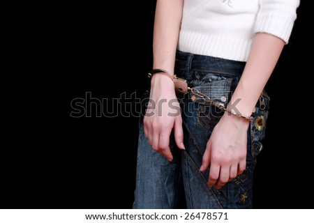 hands in shackles isolated on black - stock photo