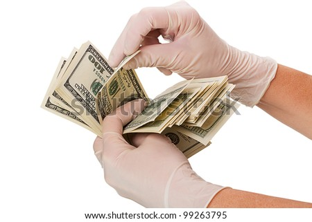Hands in surgical gloves, consider the money. Isolated on white background