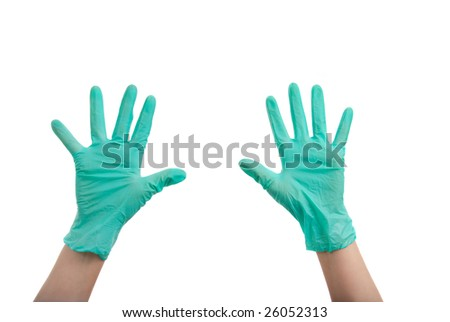 Hands in surgical gloves isolated over white background - stock photo
