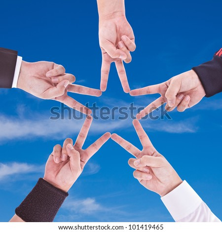 Hands in the form of a star - stock photo