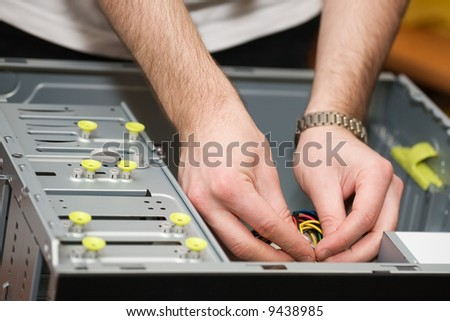 Hands in the open computer. Shallow depth of field. - stock photo