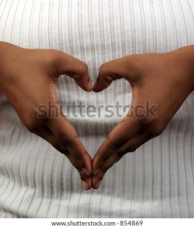 Hands in the shape of a heart. - stock photo
