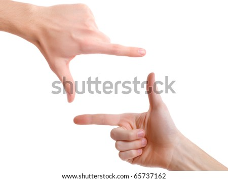 Hands in the shape of frame - stock photo
