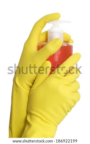 Hands in yellow gloves holding red transparent spray bottle on white background  - stock photo