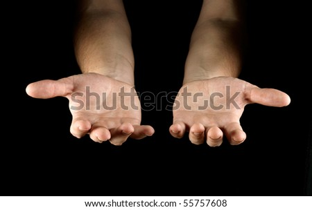 Hands isolated on black background - stock photo
