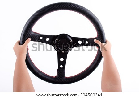 Hands kid on a steering wheel  on  white