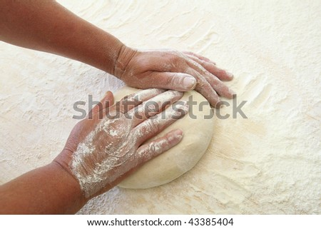 Hands make bread - stock photo