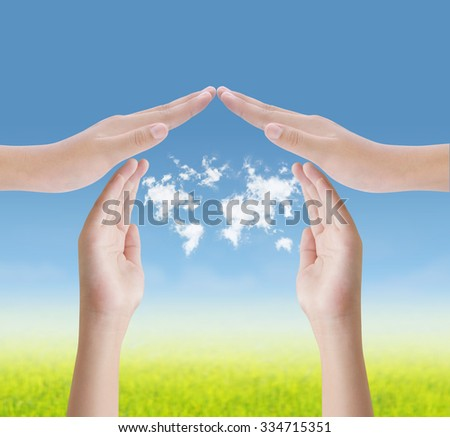Hands make house shape protect clouds map on blue sky  - stock photo