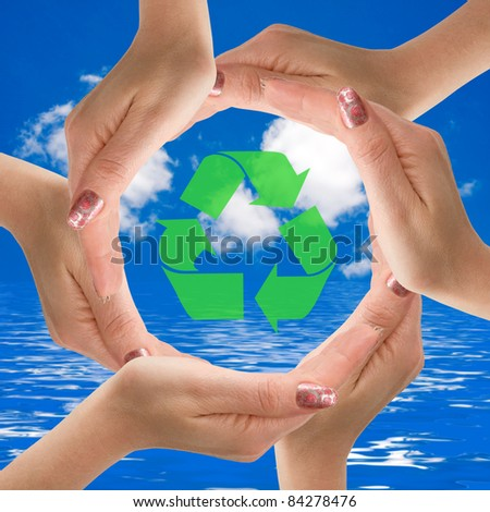 Hands making a circle  with recycle icon in the middle.