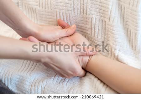 Hands massage  - stock photo