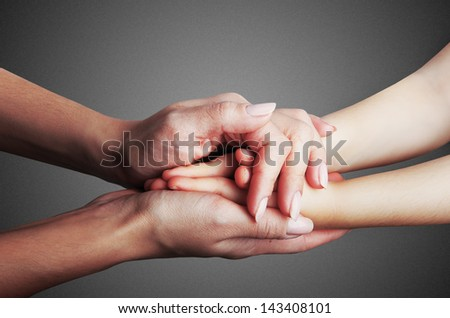 Hands mother and baby close-up - stock photo