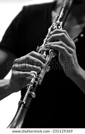 Hands musician playing the clarinet in black and white