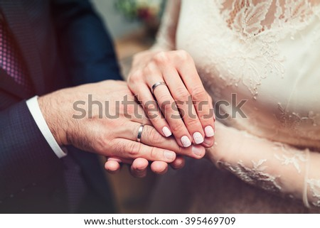 Hands newlyweds with wedding rings close up - stock photo