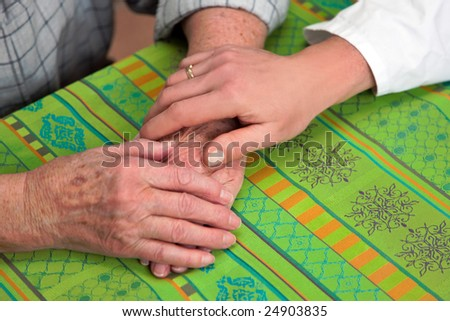 Hands nurse and an old woman - stock photo