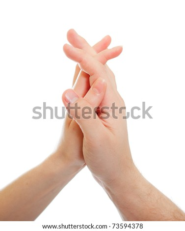 Hands of a boy and a girl put together, isolated on white. - stock photo