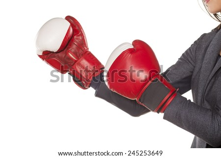 Hands of a business woman, attack with boxing gloves