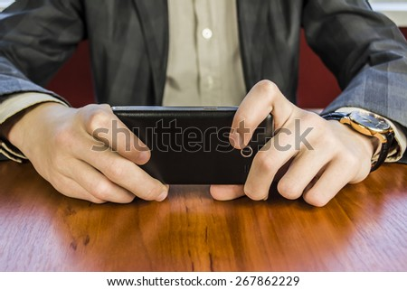 hands of a businessman holding a  smart phone