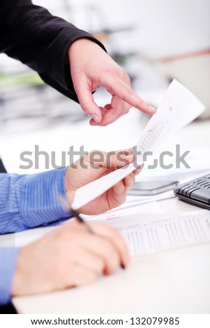 Hands of a businessman on a working table