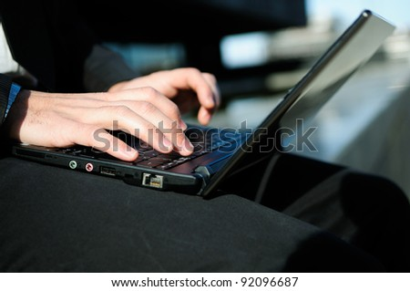 Hands of a businessman writting with a laptop computer - stock photo