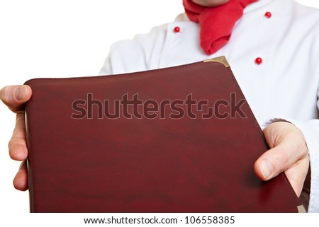 Hands of a chef cook holding menu card - stock photo